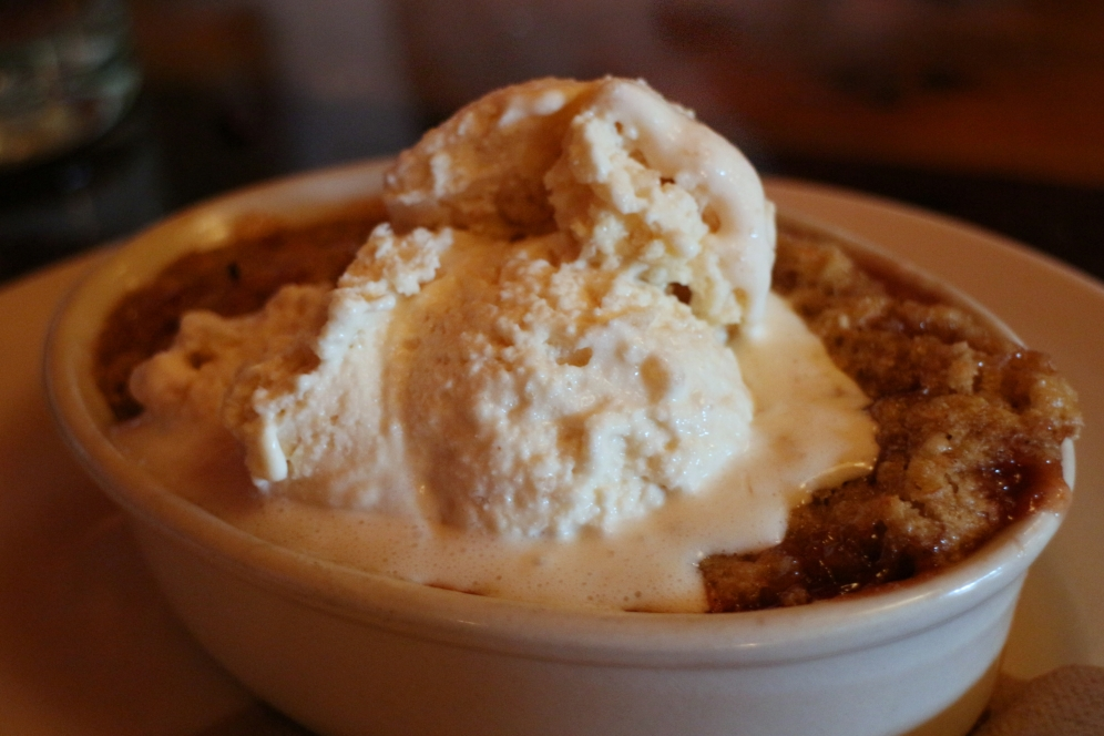 Cobbler with white plum, stewed in spices, and topped with the house peach vodka ice cream